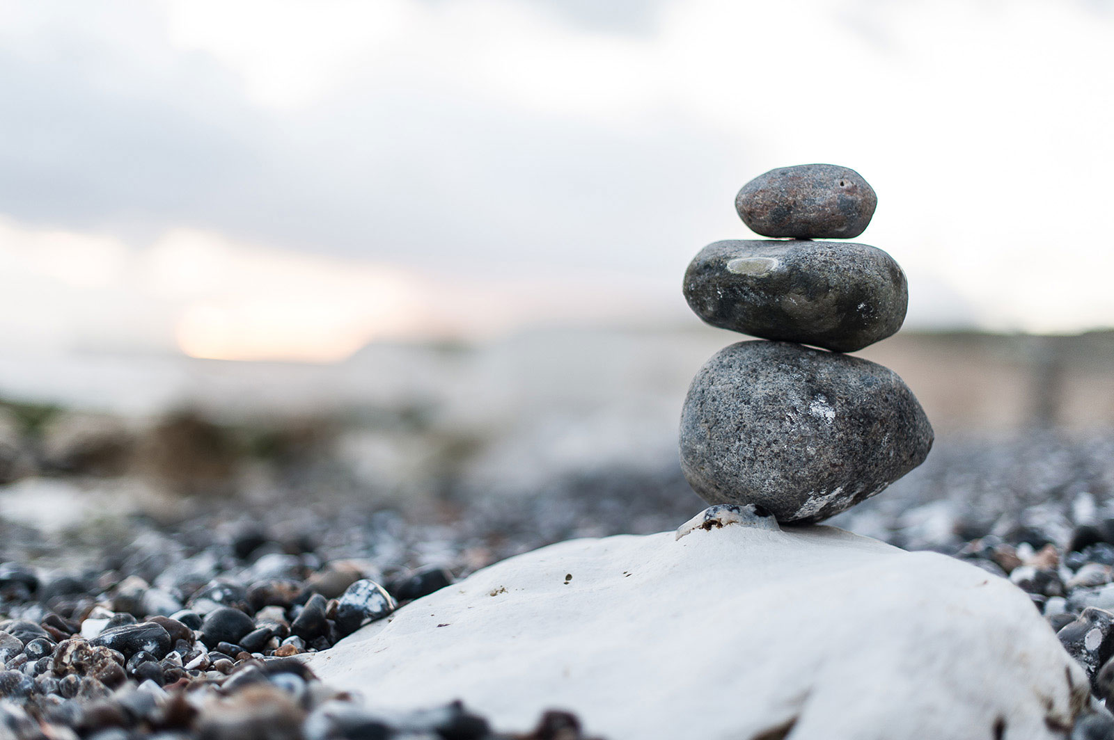 Balancing Rocks On Beach Hero Image